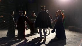 Medieval people dance in circle stock video footage