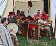 Medieval People Singing. Nogent le Rotrou,France, 11.05.2013: Group of medieval people singing in their tent using obsolete musical instruments during the Stock Photos