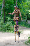 Medieval performer on stilts