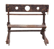 Medieval pillory. Antique device used for punishment by public humiliation and physical abuse . old wooden stocks isolated with clipping path stock image