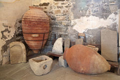 Medieval pithos and gravestones Stock Image