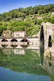 Medieval Ponte della Maddalena across the Serchio. Ponte della Maddalena mediaval bridge across the Serchio. Tuscany. Bridge of the Devil Stock Photo