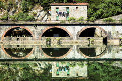 Medieval Ponte della Maddalena across the Serchio. Ponte della Maddalena mediaval bridge across the Serchio. Tuscany. Bridge of the Devil Stock Images