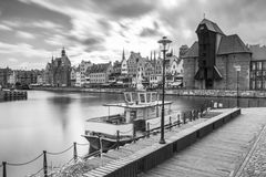 Medieval port crane over Motlawa river in Gdansk Stock Photo