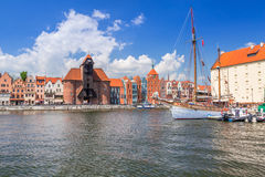Medieval port crane over Motlawa river in Gdansk Royalty Free Stock Images
