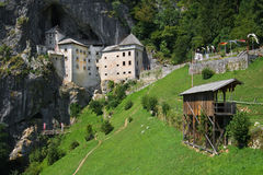 Medieval Predjama castle. Castle of Predjama, Renaissance castle built within a cave mouth, with a jousting ground in the foreground, Slovenia Stock Photos