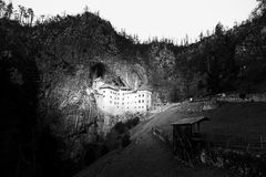 Medieval Predjama Castle near Postojna, Slovenia, Europe, black and white version stock photography