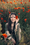 Medieval Princess in a Field of Poppies Royalty Free Stock Images