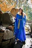 Medieval princess in stone garden Stock Image