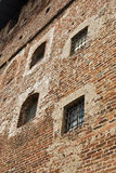 Medieval prison. Windows with bars of old italian castle Royalty Free Stock Images