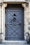 Medieval prison door in old european castle. Royalty Free Stock Image