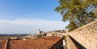 The medieval quarter of Gerona.  Costa Brava, Catalonia, Spain. The medieval quarter of Gerona with bell tower of Santa Maria cathedral in background. View from Royalty Free Stock Image