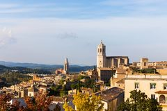 The medieval quarter of Gerona.  Costa Brava, Catalonia, Spain. The medieval quarter of Gerona with bell tower of Santa Maria cathedral in background. View from Stock Photos