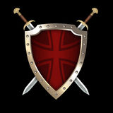 Medieval riveted shield with two swords. Stock Images