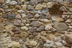 Medieval rock wall. In ancient fortress Stock Images