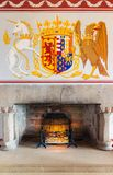 Medieval room of Stirling Castle with hearth and wall decorations. Stirling Castle, Scotland - May 19 2018: Medieval room of Stirling Castle with hearth and wall royalty free stock photography