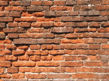 Medieval rough brick wall of earth and terracotta colored bricks Stock Photos