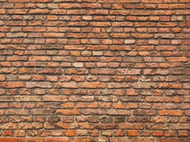 Medieval rough brick wall of earth and terracotta colored bricks Stock Photography