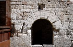 Medieval round arch with stones - Black hole. Spello, Umbria, Italy Royalty Free Stock Photography