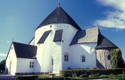 Medieaval round church in Osterlars in Bornholm island. Medieval round defence church built in the middle ages in village of Osterlars in the island of Bornholm royalty free stock photos