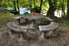Medieval round table with a red candle Royalty Free Stock Photography
