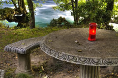 Medieval round table with a red candle Stock Image