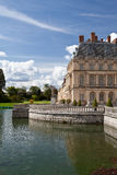 Medieval royal castle and lake near Paris Stock Photography