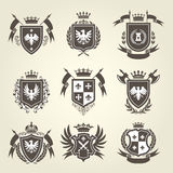 Medieval royal coat of arms and knight emblems - heraldics Stock Photos