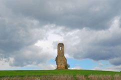 Medieval ruin of church tower alone in the field, Slovakia stock photography