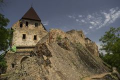 Medieval ruins of the castle. Medieval castle ruins on top of the rock stock photo
