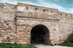 The medieval ruins of the fortress. The passage in the form of an arch made of stones Stock Photography