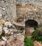 The medieval ruins of the fortress. The passage in the form of a. N arch made of stones Royalty Free Stock Photos