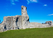 Medieval ruins on a grassy hill Royalty Free Stock Image