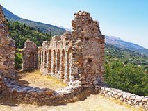 Medieval ruins at the ancient site of Mystras, Greece. Medieval ruins located at the ancient hillside site of Mystras in Greece Royalty Free Stock Images