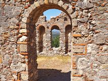 Medieval ruins at the ancient site of Mystras, Greece. Medieval ruins located at the ancient hillside site of Mystras in Greece Royalty Free Stock Image
