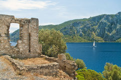 Medieval ruins with sea and mountains at background Royalty Free Stock Image
