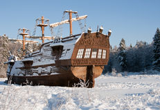 Medieval sail ship. Vintage sail ship stern snow covered on a sunny day Royalty Free Stock Images