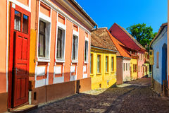 Medieval saxon street view in Sighisoara,Transylvania,Romania,Europe. Stone paved old streets with colorful houses in Sighisoara fortress,Transylvania,Romania Stock Image