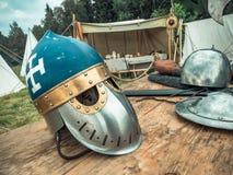 Medieval scene. Medieval knight attributes are helmet, chain mail, shield buckler, sword, halberd. Reconstruction of medieval life. Medieval scene. Medieval Royalty Free Stock Photo
