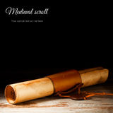 Medieval scroll. Over grunge wooden table Royalty Free Stock Image