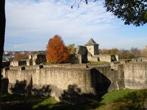 The medieval Seat Fortress of Suceava in autumn sunlight stock photo