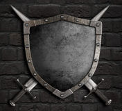 Medieval shield with crossed swords on brick wall 3d illustration Royalty Free Stock Images