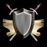 Medieval shield with scroll and two swords. Royalty Free Stock Photography