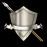Medieval shield with spears and silver ribbon. Royalty Free Stock Photography