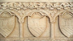 Medieval shield in stone wall texture backgrouund.  stock photography