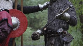 Medieval soldier in armor is getting his first sword stock footage