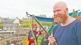 Medieval soldier with flail. Medieval soldier holding dangerous weapon called a flail at the traditional Scottish Boat Festival held at Portsoy on 16th and 17th Stock Photo