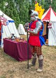 Medieval Soldier guarding camp, Tewkesbury Medieval Festival, England. A participant at the Tewkesbury Medieval Festival in Gloucestershire, England dressed as Stock Image