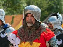 Medieval Soldier Portrait, Tewkesbury Medieval Festival, England. A participant at the Tewkesbury Medieval Festival in Gloucestershire, England dressed in royalty free stock images