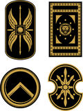 Medieval Soldier Shields. Set of varied design shields of Romans, Trojan and Spartan Stock Photos